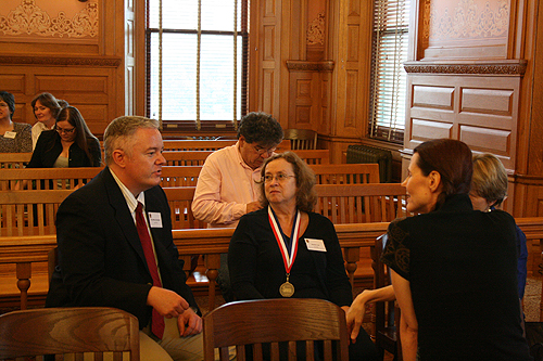 Paul Miles Schneider arrives early (of course) and chats with fellow honorees, including former poet laureate of Kansas, Denise Low (center), and others, at the 2010 Kansas Notable Books ceremony.