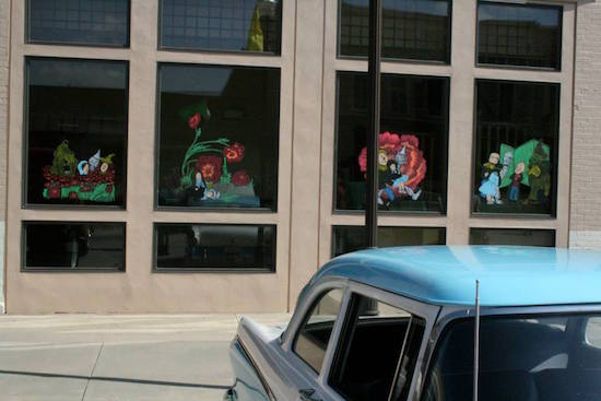Wonderful window art based on the original W.W. Denslow Oz illustrations! The windows of all the storefronts were painted on both sides of the street. OZtobeFest 2014, Wamego, Kansas.