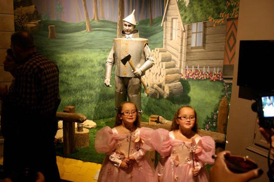 Twin Glindas stop for a photo op, unaware that the Tin Man behind them is about to come to life! Night at the Museum, OZtoberFest 2014, Wamego, Kansas.