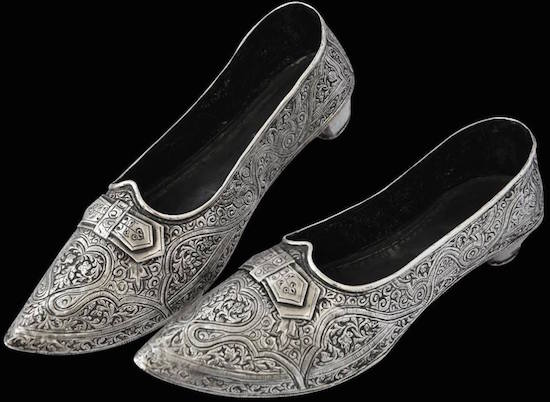 A photo of silver shoes from the eighteenth century.