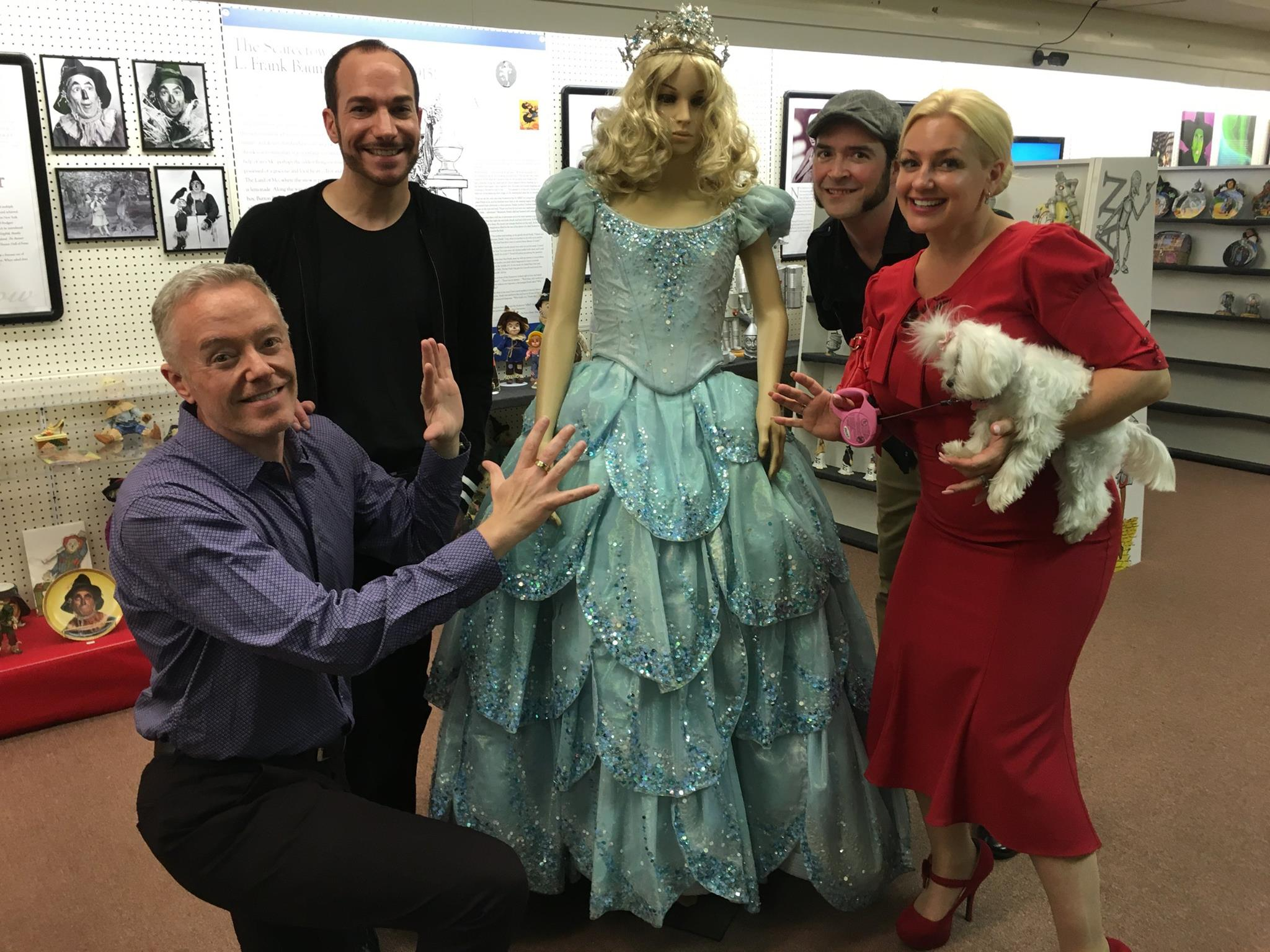 "Fun with good friends and new friends as we oogle Glinda's dress from the Broadway production of ""Wicked,"" on loan to the All Things Oz Museum for the next two months! (Left to right:) Paul Miles Schneider, Ryan Jay, Vincent Myrand, and Emma Ridley."