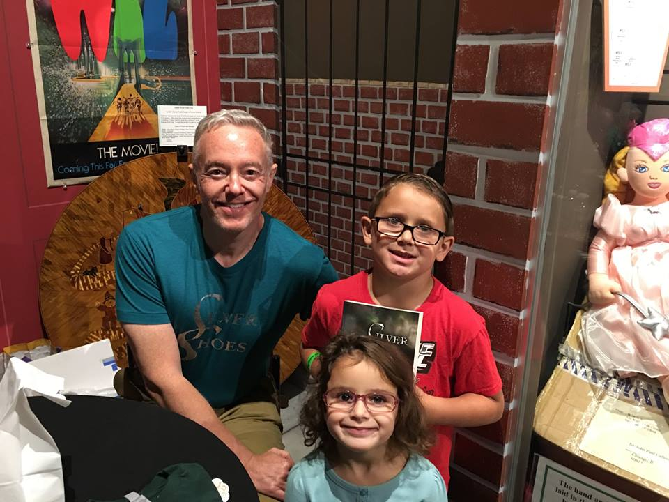 """Silver Shoes"" author Paul Miles Schneider enjoys a meet-and-greet with young fans during OZtoberFest 2016."