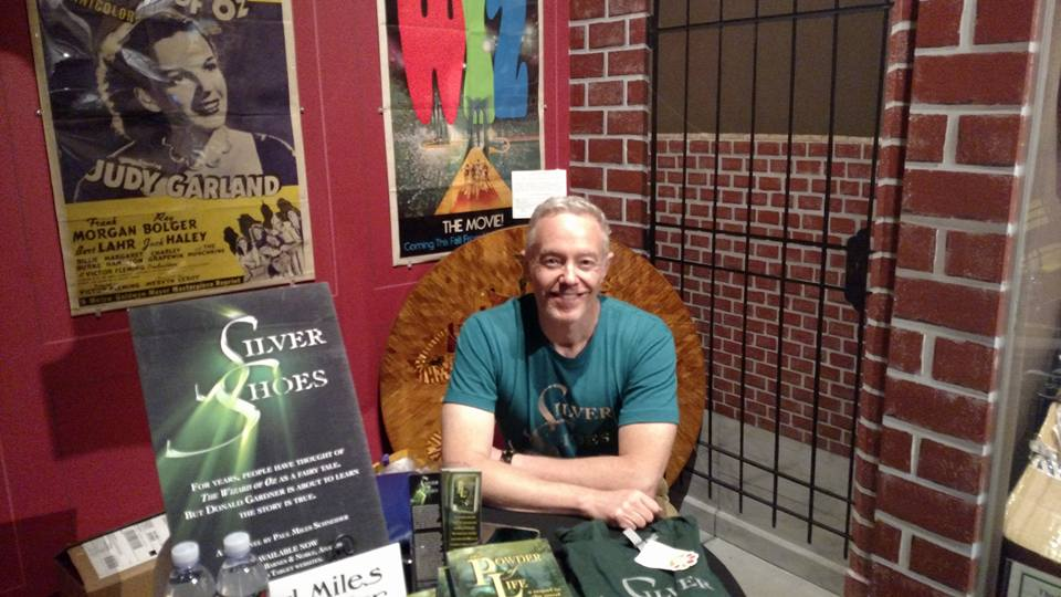 Author Paul Miles Schneider sits at his traditional perch in the Oz Museum for OZtoberFest 2016, in Wamego, KS. Selling and signing books.